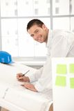 Happy young architect working in office royalty free stock image