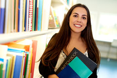 Happy young art student at the college library Stock Image