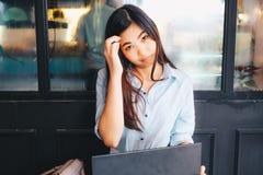 Happy young asian beautiful smiling women using laptop Royalty Free Stock Photo