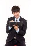 Happy young Asian business man Stock Photos