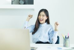 Happy young asian business woman finished her work at workplace. Happy young asian business woman finished her work at workplace royalty free stock photography