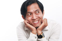 Happy Young Asian Businessman Thinking Stock Photo
