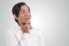 Happy Young Asian Businessman Thinking Royalty Free Stock Photos