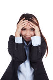 Happy young Asian businesswoman with hand on her head Royalty Free Stock Image