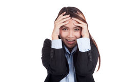 Happy young Asian businesswoman with hand on her head Stock Images