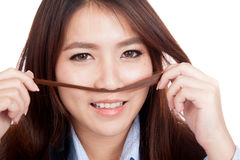 Happy young Asian businesswoman play with her hair Stock Image