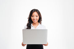 Happy young asian businesswoman standing with laptop Royalty Free Stock Photography