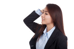 Happy young Asian businesswoman touch her head close her eyes Stock Photography