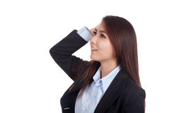 Happy young Asian businesswoman touch her head look up Stock Photography