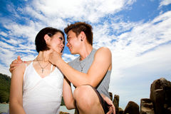 Happy young asian couple at the beach Stock Photos