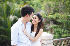 Happy young asian couple in a park Royalty Free Stock Photography