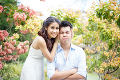 Happy young asian couple in a park Stock Photography