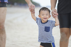 Happy Young Asian Family Having Fun Walking on at tropical beach. Vacation outdoors, Concept of happy father day. Shallow DOF Stock Images