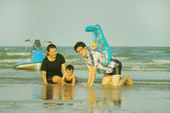 Happy Young Asian Family Having Fun Walking on at tropical beach. Vacation outdoors, vintage tone, Shallow DOF, Concept of happy father day Royalty Free Stock Photos