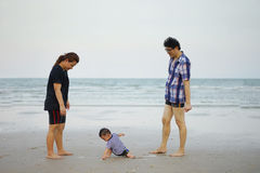 Happy Young Asian Family Having Fun Walking on at tropical beach. Vacation outdoors, vintage tone, Shallow DOF, Concept of happy father day Royalty Free Stock Photo