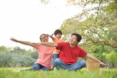 Happy Asian family having fun. Happy young Asian family with their daughter having fun in nature at park outdoor royalty free stock photos