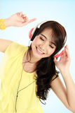 Happy Young asian girl with headphones Royalty Free Stock Images