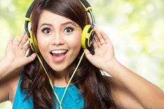 Happy Young asian girl with headphones Stock Photo