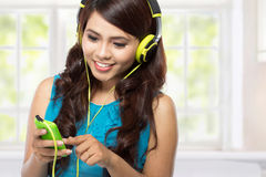 Happy Young asian girl with headphones Royalty Free Stock Image
