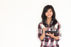 Happy young asian girl holding a tablet pc. Represent both business and educational matter Stock Photography