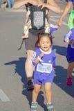 Happy young asian girl running Stock Photos