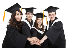 Young graduate students group with success gesture