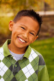 Happy young Asian kid smiling and laughing. Royalty Free Stock Photos