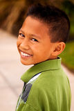 Happy young Asian kid smiling and laughing. Royalty Free Stock Photo