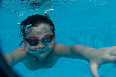 Happy young asian kid with swim goggles underwater Stock Image