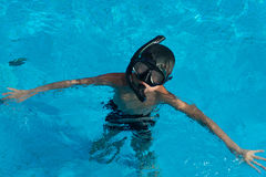 Happy young asian kid with swim goggles underwater Royalty Free Stock Photography