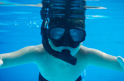 Happy young asian kid with swim goggles underwater Stock Photos