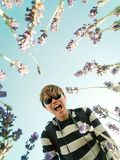 Happy young asian looks down into the camera in lavender field stock images