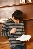Happy young asian man with book Stock Photo