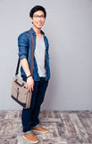 Happy young asian man standing in jeans wear Royalty Free Stock Photo