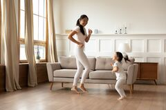 Free Happy Young Asian Mom And Daughter Dancing At Home Stock Image - 170451051