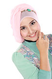 Happy young asian muslim woman in action Stock Photo