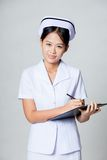 Happy young Asian nurse is working Royalty Free Stock Photography