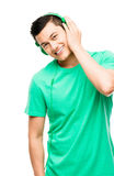 Happy young Asian student with headphones Stock Photos