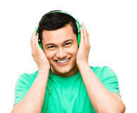 Happy young Asian student with headphones. Listening to music Stock Images