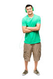Happy young Asian student with headphones. Listening to music full length Stock Images