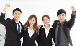 Happy young business team in office royalty free stock images