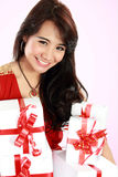 Happy young asian woman bring gift boxes Royalty Free Stock Images