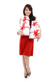 Happy young asian woman bring gift boxes Royalty Free Stock Image