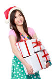 Happy young asian woman bring gift boxes. Portrait of smiling young woman holding some gift boxes Stock Photography