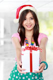 Happy young asian woman bring gift boxes. Portrait of smiling young woman holding some gift boxes Stock Photos