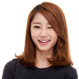Happy young Asian woman close up shot. Royalty Free Stock Photo