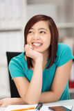 Happy young Asian woman daydreaming Royalty Free Stock Photo