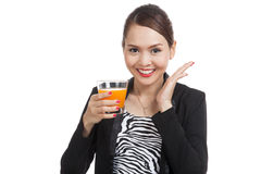 Happy Young Asian woman drink orange juice Stock Photo