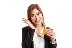 Happy Young Asian woman drink orange juice Royalty Free Stock Photography