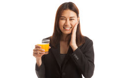 Happy Young Asian woman drink orange juice. Royalty Free Stock Photo